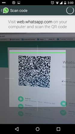 A mobile phone scanning the QR Code for WhatsApp Web.